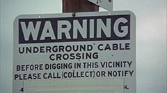 Warning / Underground cable crossing / Before digging in this vicinity please call collect or notify