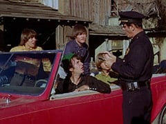 Davy Jones, Mike Nesmith, Micky Dolenz, Peter Tork, 1st Cop (Hollis Morrison)