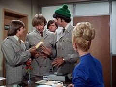 Davy Jones, Peter Tork, Micky Dolenz, Mike Nesmith, Secretary (Judy Howard)