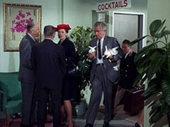 Woman in Blue Dress (?), Conventioneer (Foster Brooks), Bellhop (?)
