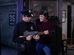 Cop (Robert Michaels), Micky Dolenz