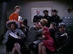 Woman with Hat (?), Peter Tork, Mike Nesmith, Sergeant (Dort Clark), Kissing Man (?), Kissing Woman (?), Cop (Robert Michaels), Micky Dolenz, Cop #2 (?), Unamused Movie-goer (?)