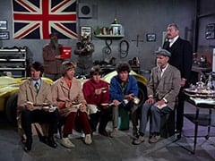 Mike Nesmith, Wolfgang (Stubby Kaye), Peter Tork, Baron Von Klutz (David Hurst), Davy Jones, Micky Dolenz, T.N. Crumpets (William Glover), Carruthers the Butler (Maurice Dallimore)