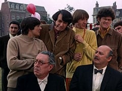 Davy Jones, Butler (Reginald Gardiner), Mike Nesmith, Peter Tork, Mr. Friar (Laurie Main), Micky Dolenz