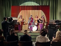 Maxine (Sharon Cintron), William the Conquerer (Deana Martin), West Minstrel Abbey Drummer (Valerie Kairys), West Minstrel Abbey Guitarist (?)