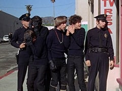 Davy Jones, Mike Nesmith, Peter Tork, Micky Dolenz, Cop (Robert Michaels)